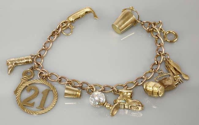 A 9ct gold charm bracelet. Sold for £220 on 24/02/16