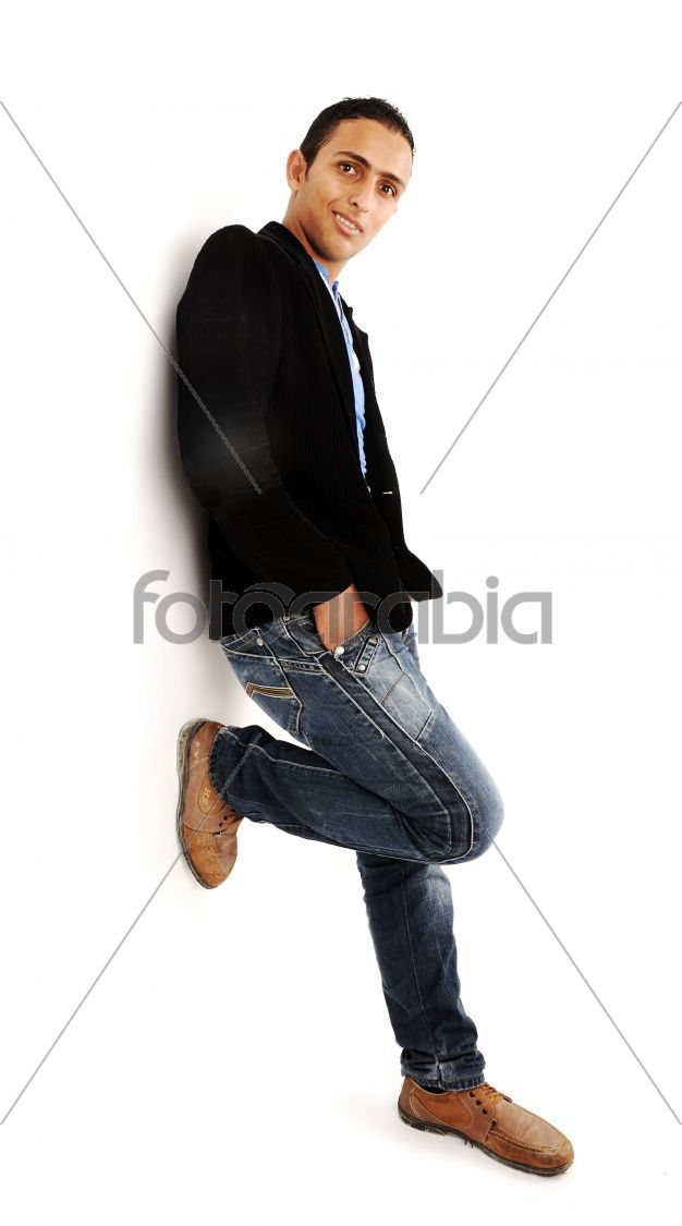 Handsome Young Man Leaning Against The Wall Stock Photo Fotoarabia Handsome Stock Photos Man