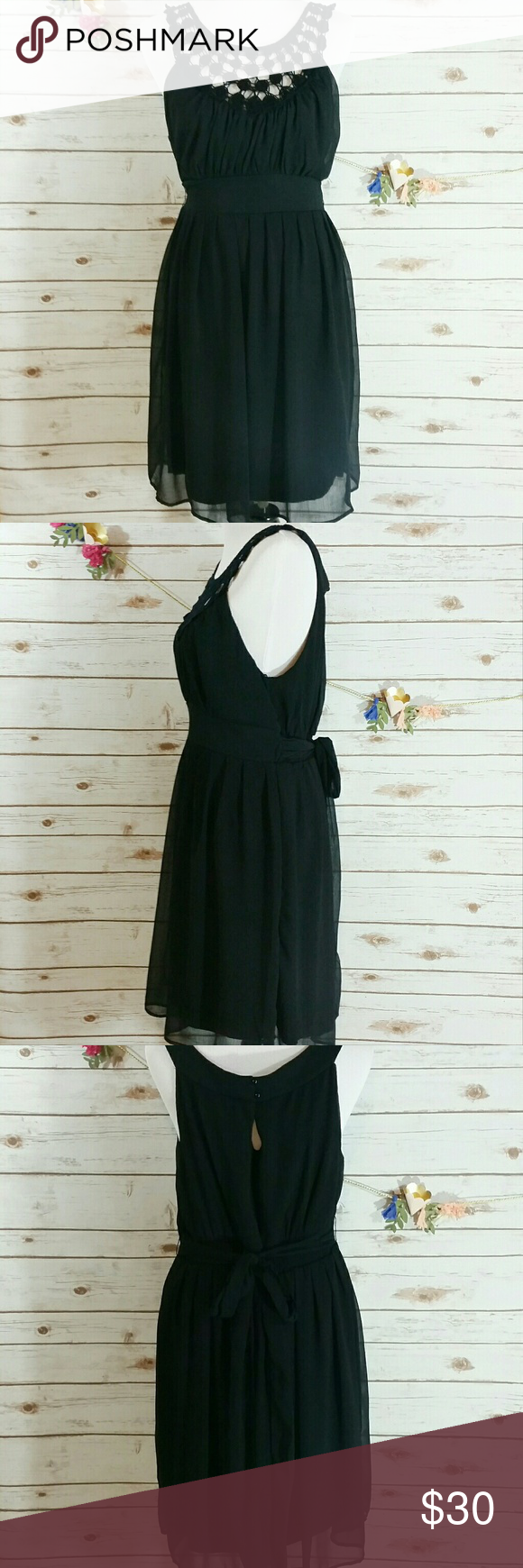 "Black crochet top dress with sheer overlay This dress has a crochet like top, sheer overlay, and a ribbon tie in back. It also has two small buttons at the top and a cut out below that. 100% polyester. Length is approx 27"", bust is approx 34"". Jonathan Martin Dresses Midi"