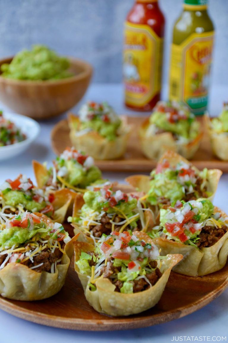Easy Taco Salad Cups on a wood serving plate with hot