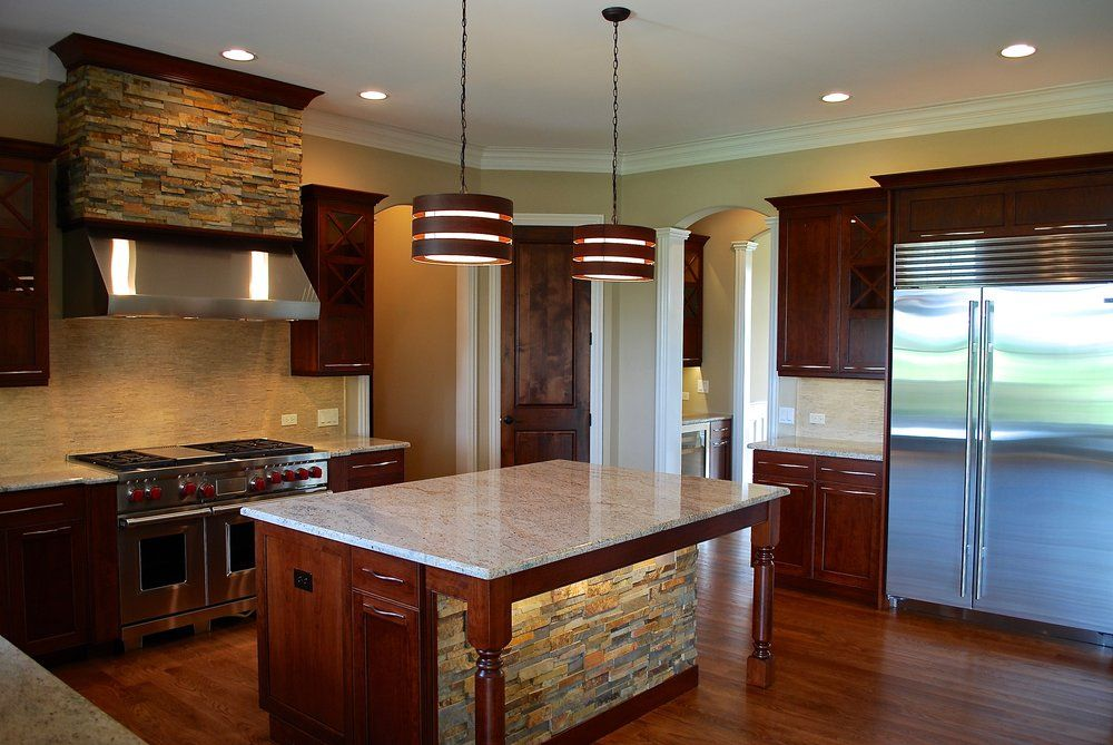 Custom Stone Hood Custom Stone Island 48 Sub Zero Fridge Wide Cabinet Pulls Prairie Lakes Custom Kitchen Remodel Kitchen Remodel Complete Kitchen Remodel