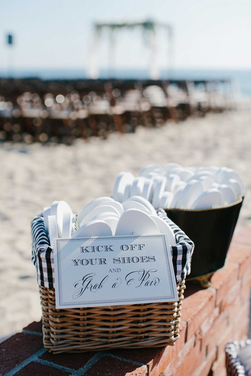 Basket of Flip-Flops for Guests    Photo: John Schnack Photography. View More:  http://www.insideweddings.com/weddings/sweet-simple-beach-wedding-with-wood-detailing-in-california/870/