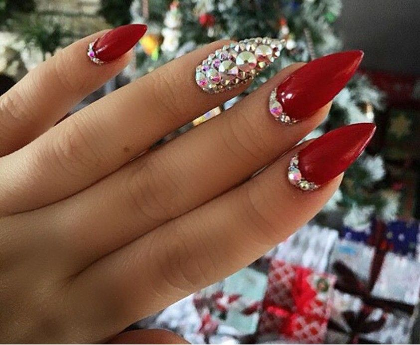 red stiletto nails with rhinestones