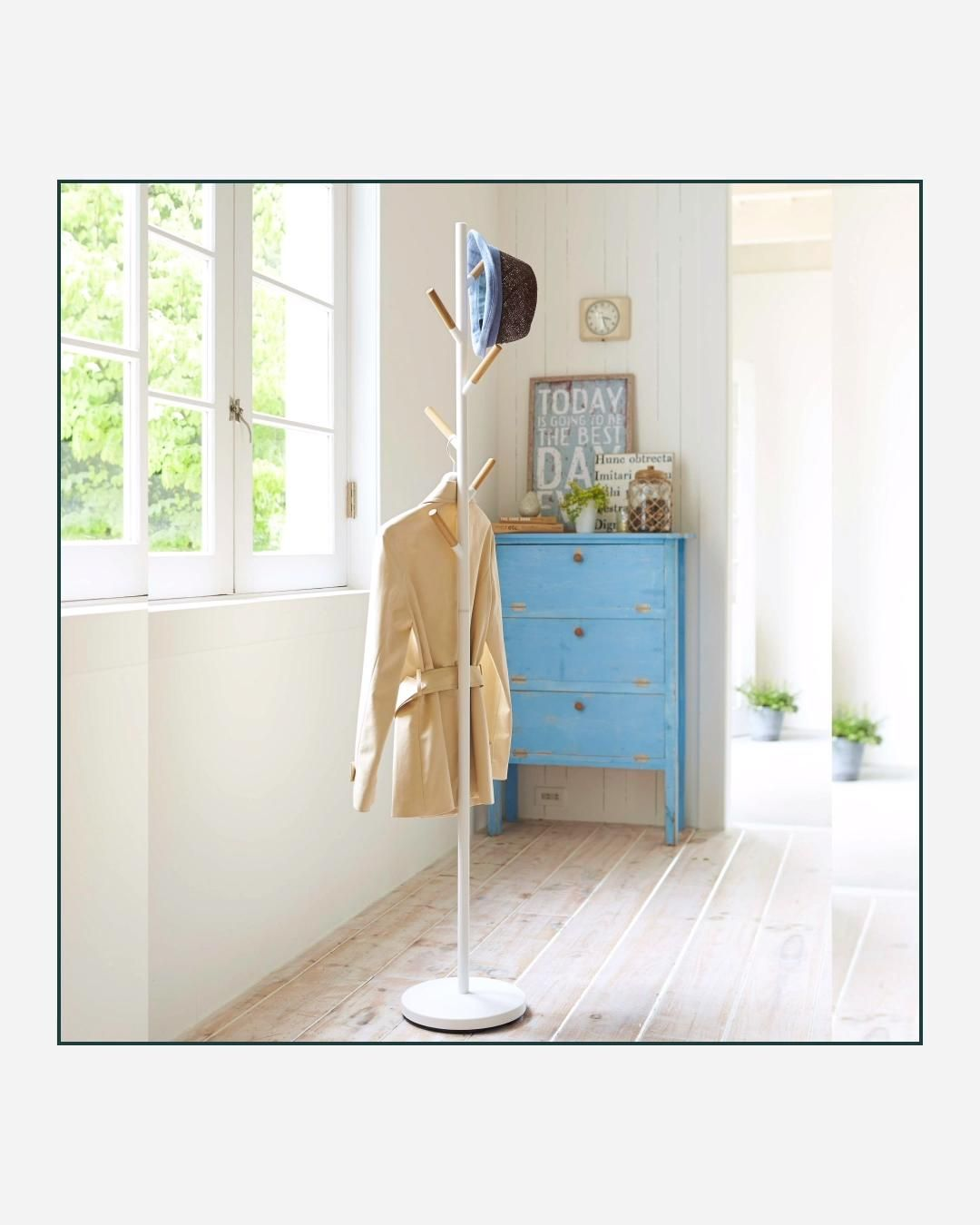 A clean, modern coat rack with a small footprint. Tucks away neatly into any entryway, living room, or office. It features a metal frame and the six decorative pegs, or branches, which lend a touch of warmth. The weighted base keeps everything perfectly stationary and standing. Use coat hangers or simply drape your coats, jackets, scarves, and hats on any of the six wood-tipped coat hooks.