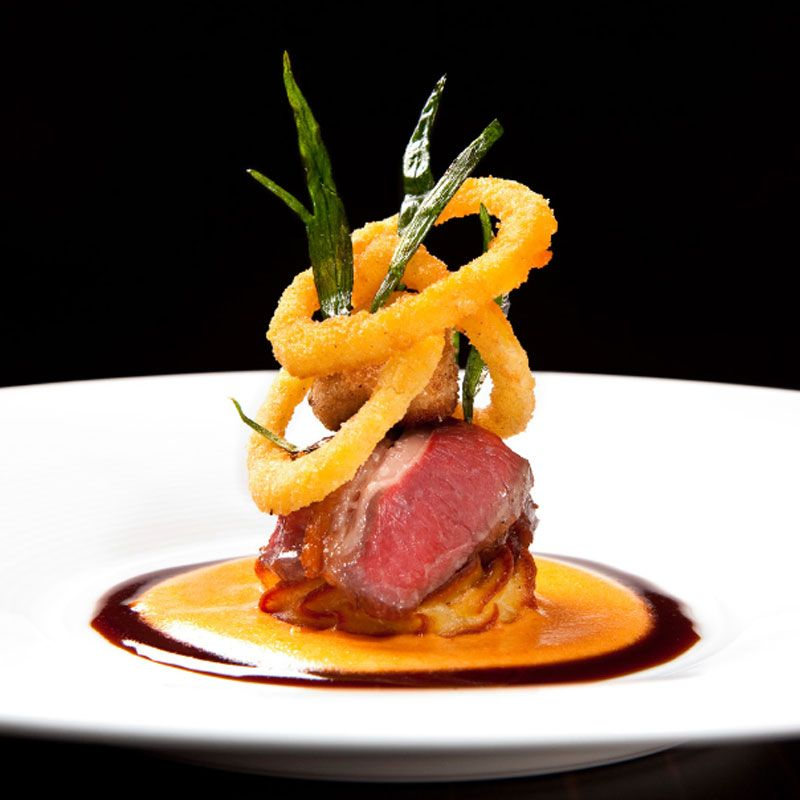 "Creative Plating - Carre d'Agneau lamb loin with onions and tarragon from Next Restaurant's ""Escoffier, Paris 1906″ menu."