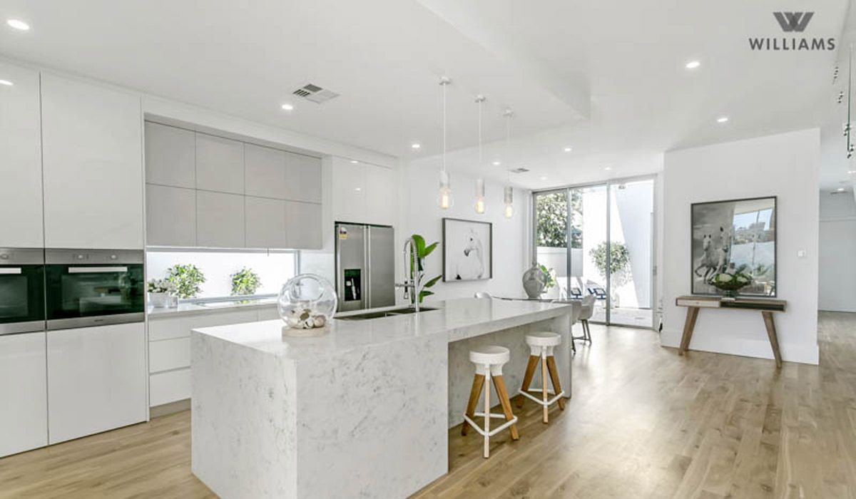 This luxury home is situated paces from the beach. Light filled ...