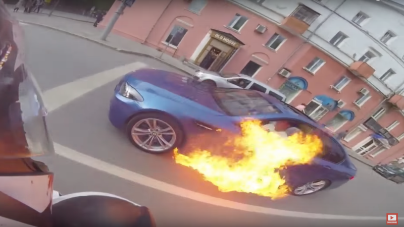 In What Seems To Be The Weirdest Video Going Around Online These Days A Bmw Is Shown Simply Catching Fire While Cruising On Public Roads