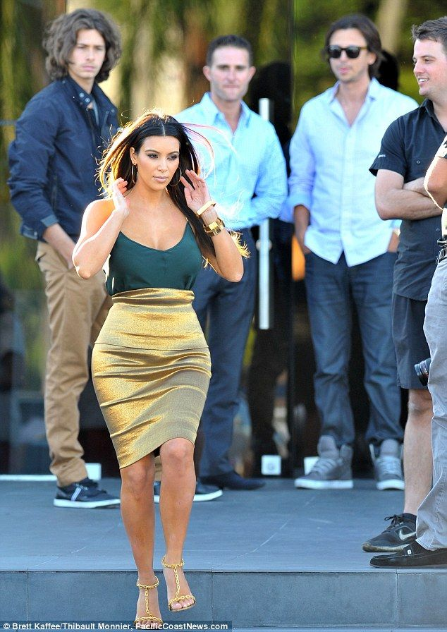 Occasionally Kim Kardashian gets is right and I will give her credit with this gold skirt.