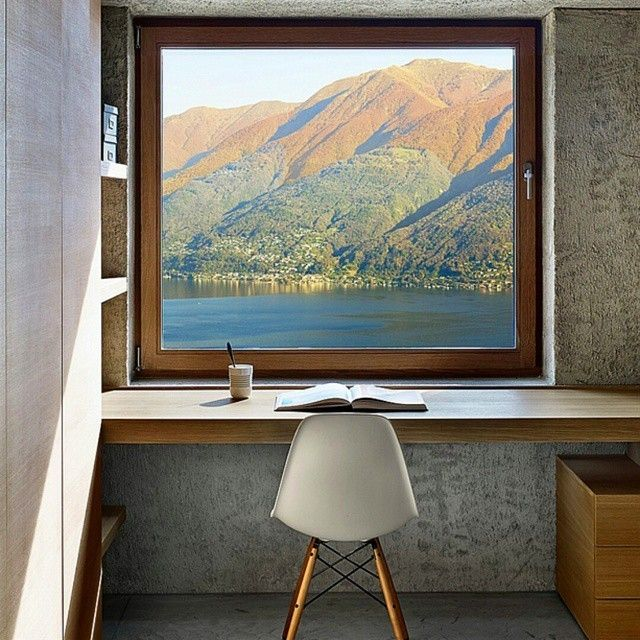 What might look like a trompe l'oeil is actually a view of the Swiss Alps from a vacation home by Wespi de Meuron Romeo. A heavenly view, from the comfort of an Eames Eiffel chair #interiordesignmag #switzerland #minimalist #eames... - Interior Design Ideas, Interior Decor and Designs, Home Design Inspiration, Room Design Ideas, Interior Decorating, Furniture And Accessories