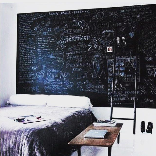 Large chalkboard as head board-guest house