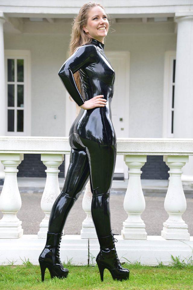 2dd7179d924 Blonde in black latex catsuit in public