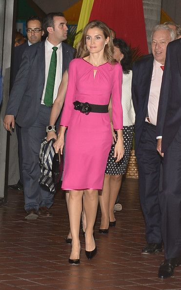 Spain's Princess Letizia pretty in pink cocktail dress with a fashionable black belt, she kept her look simple with a pair of black leather pointed stiletto heels and carried a matching black clutch as she attends the Miami Book Fair International 2013 Inaugural event in Miami, Florida.