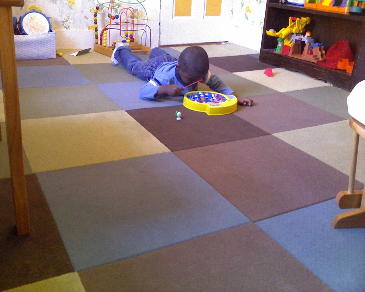 Muted playroom floor really like the different colors Playroom flooring ideas
