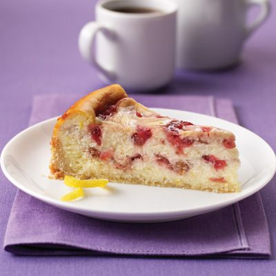 Strawberry and rhubarb filling makes this cheesecake extra-special.