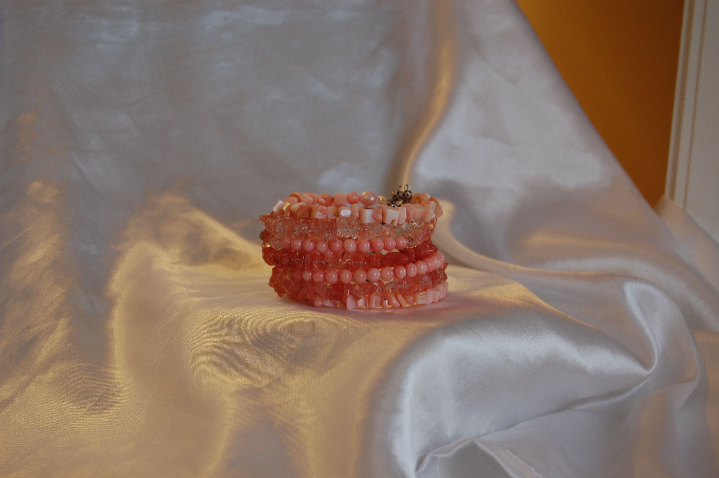 coral color beaded bracelet.