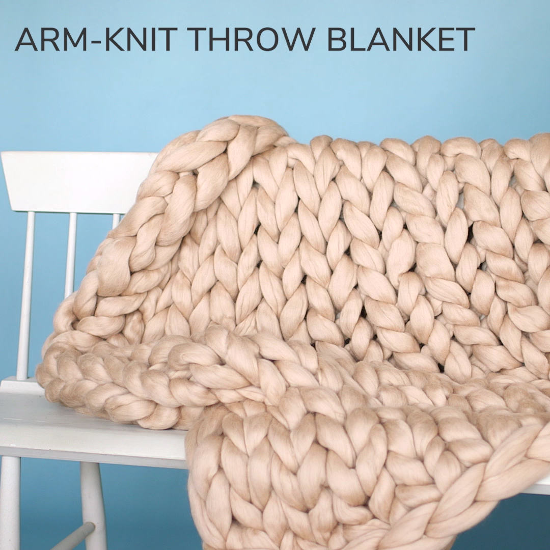 Arm Knit Throw Blanket | Snuggle up in a big cozy blanket made by hand, literally.  Simply use your arms as knitting needles to make this gorgeous, chunky-knit throw blanket.  #knitting #knittingprojects #marthastewart