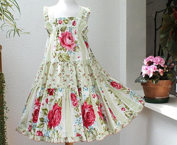 Handmade girls summer dress for ages 2-3 years in ladybird cotton fabric and adjustable straps