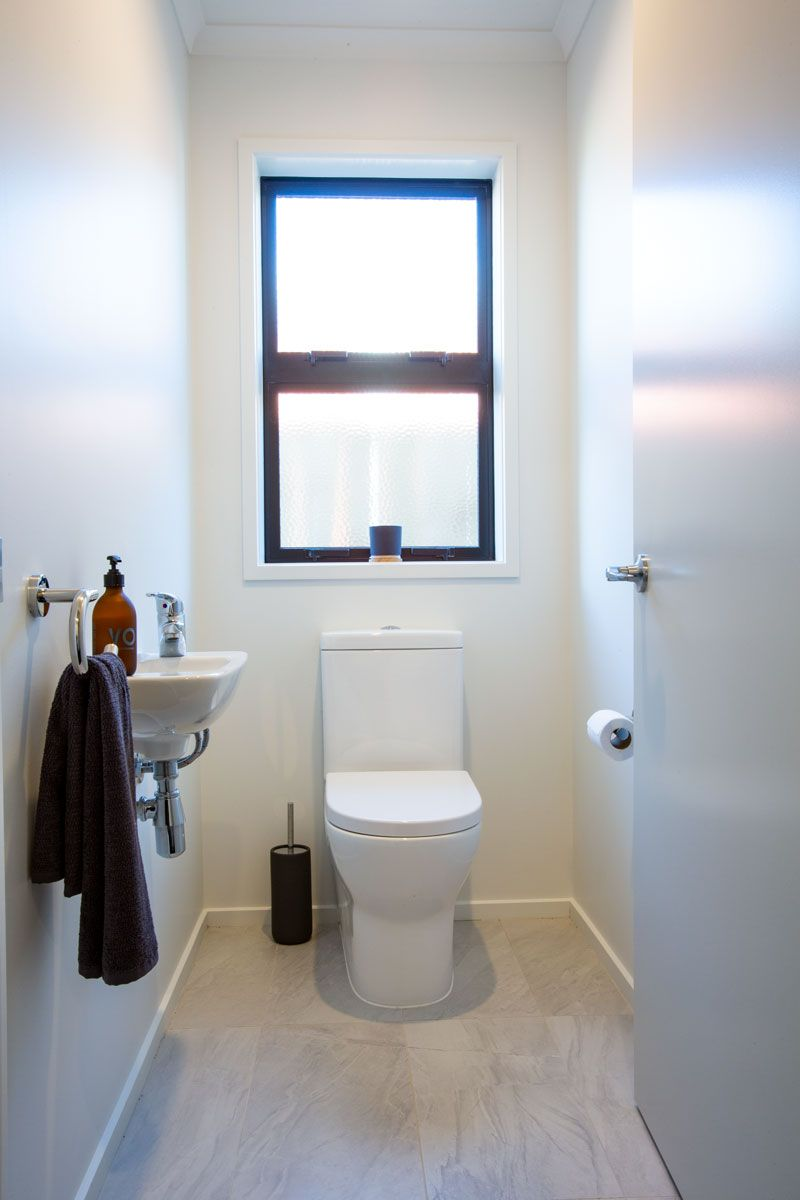 Simple White Toilet With Dark Accessories Watercloset Lavatory
