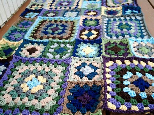 Current project I am working on, it is going to be one big blanket.  15 different colors, but all various shades of blue, green, gray, tan, brown, yellow.  The color is slightly off in this photo