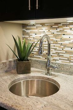 LIke The Lighting, The Backsplash And The Sink And Faucet.