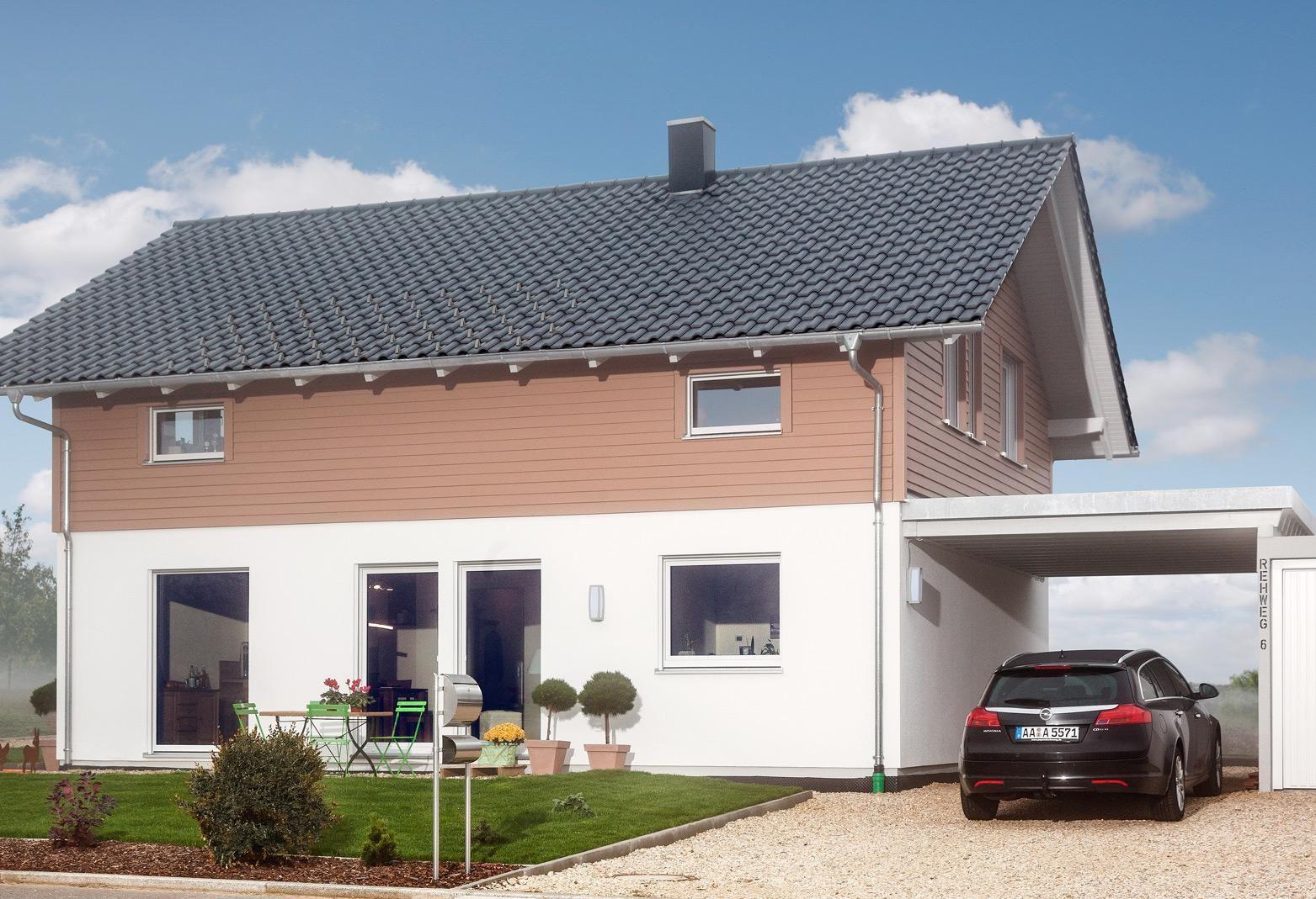 Freistehendes Einfamilienhaus mit Carport und Garage (avec