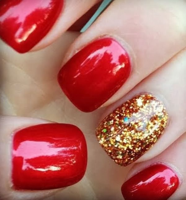 Red and gold sparkle manicure