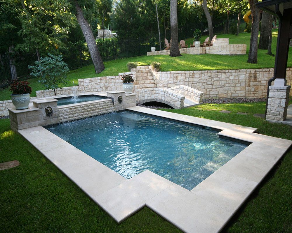 205 traditional pool and spa with step down overflow lion for Pool edges design