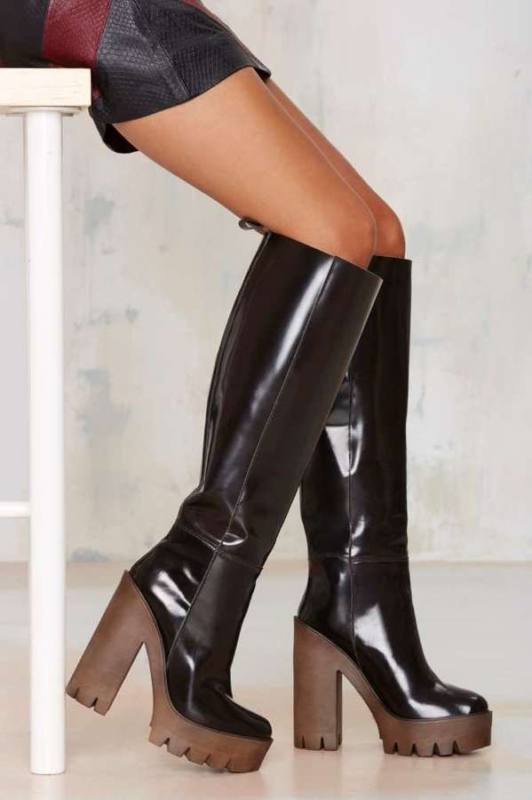 3871cb9ec1a8 Were head over heavy-duty heels for these babies. The Cindy Boot is made in  brown patent leather and features heel and platform