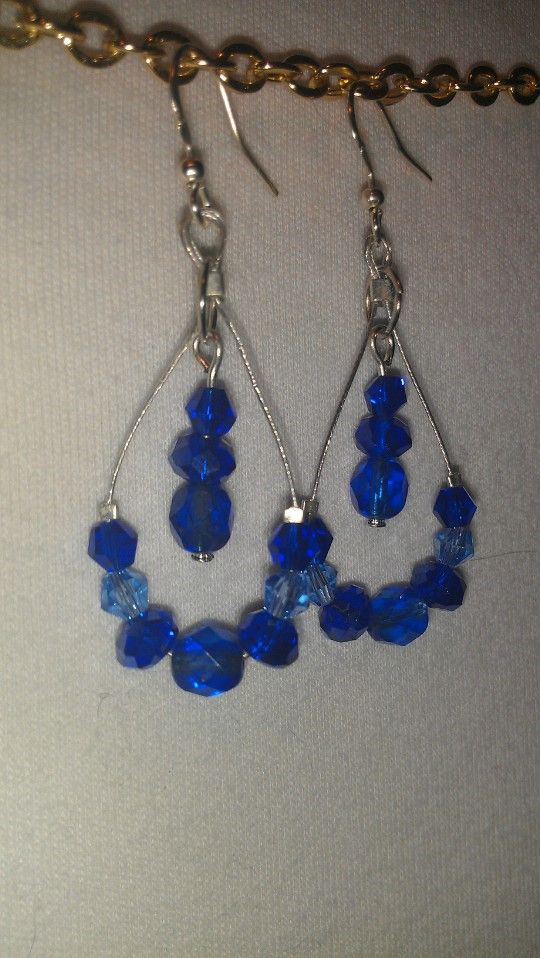 I started making these earrings in every bead color I have! They look really nice on the ear!!