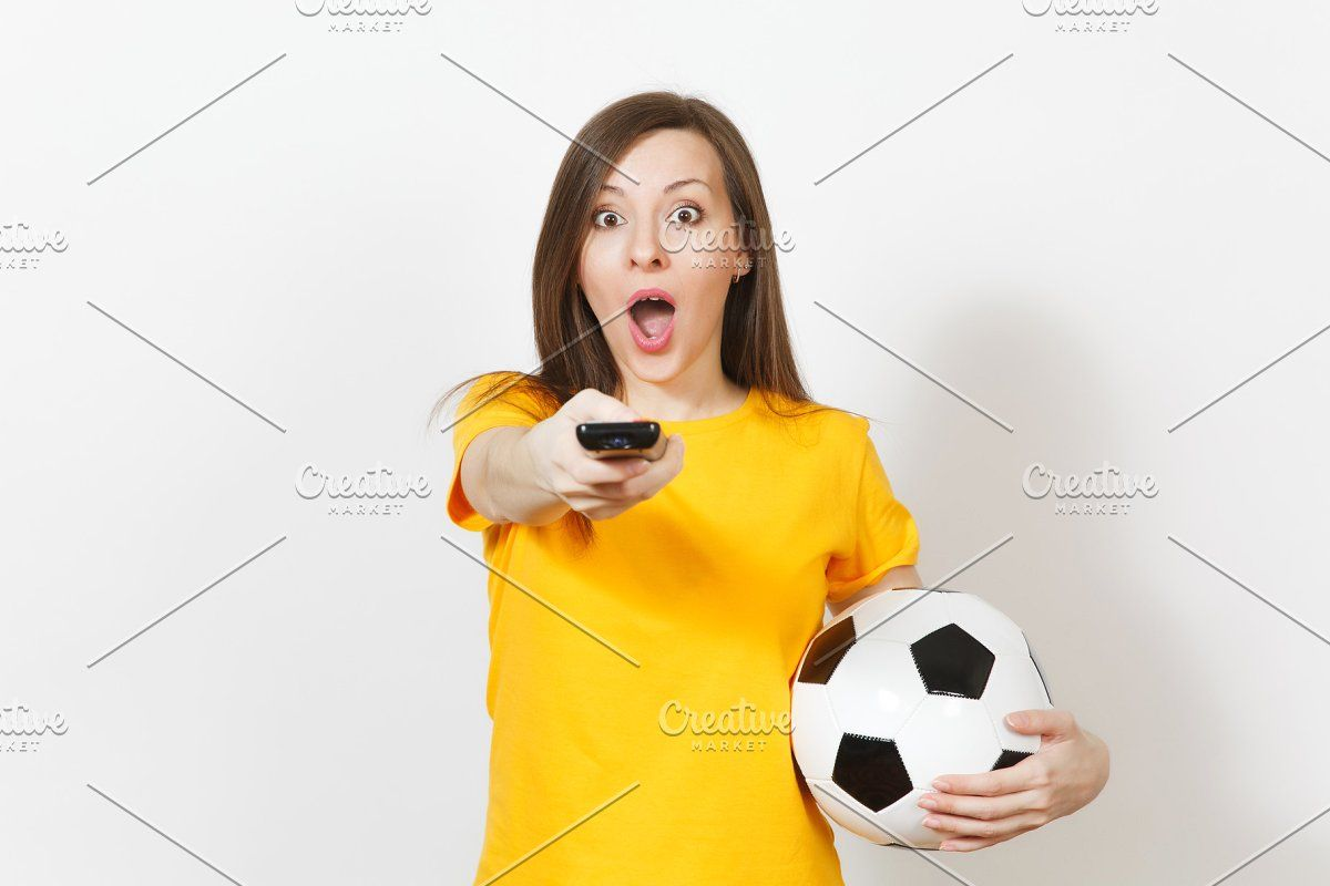 Beautiful European Young Cheerful Woman Football Fan Or Player In Yellow Uniform Hold Tv Remote Soccer Ball Isolated On White Back Football Fans Soccer Ball Soccer