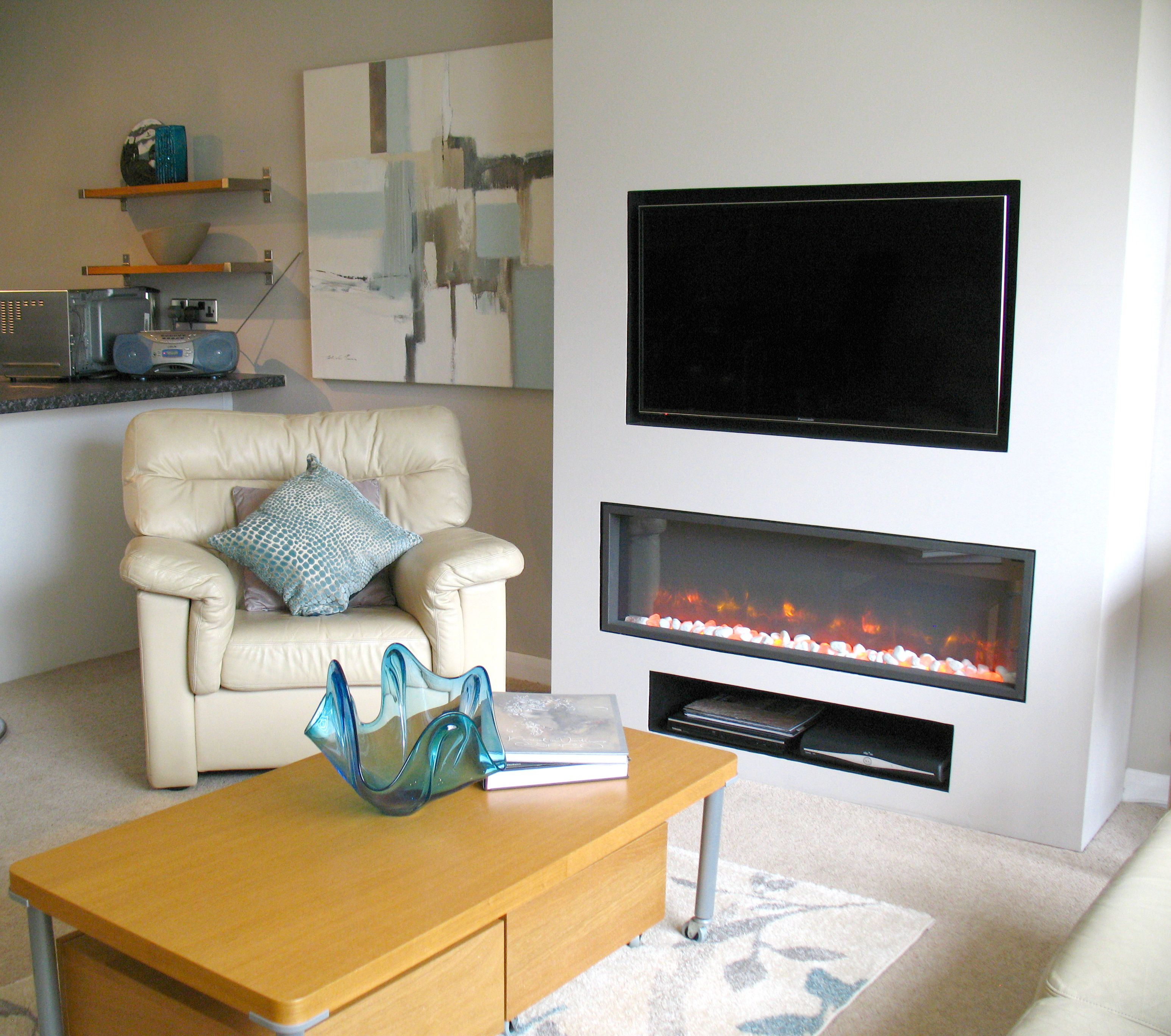 TELEVISION OVER ELECTRIC INSET FIRE. We Built A False Chimney Breast And  Created A Recess
