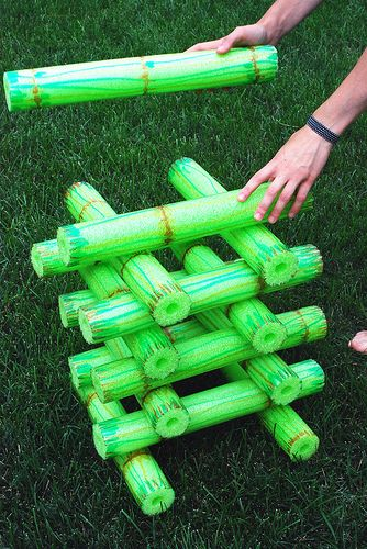 bamboo stacking game made out of pool noodles decorated with