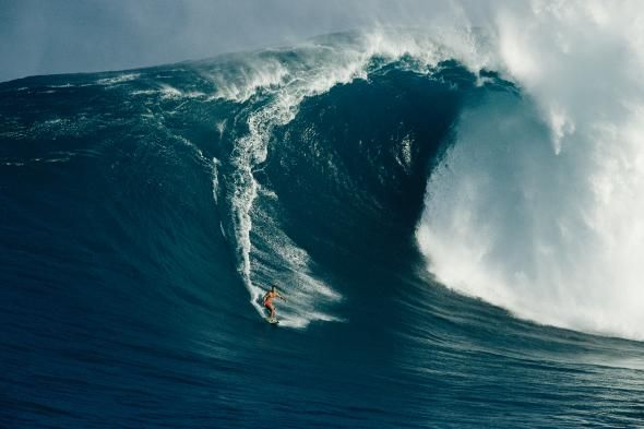 Picture of a surfer riding a big wave off the north shore of Maui Island