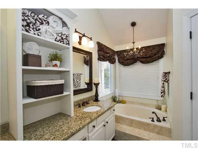 Chandelier over the bathtub... I like :)