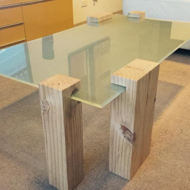 new glass coffee table with solid timber legs and battery lighting