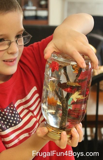 """Fall Leaf """"Snow"""" Globes. Love this fall craft idea for kids! The leaves fall when you shake the jar."""