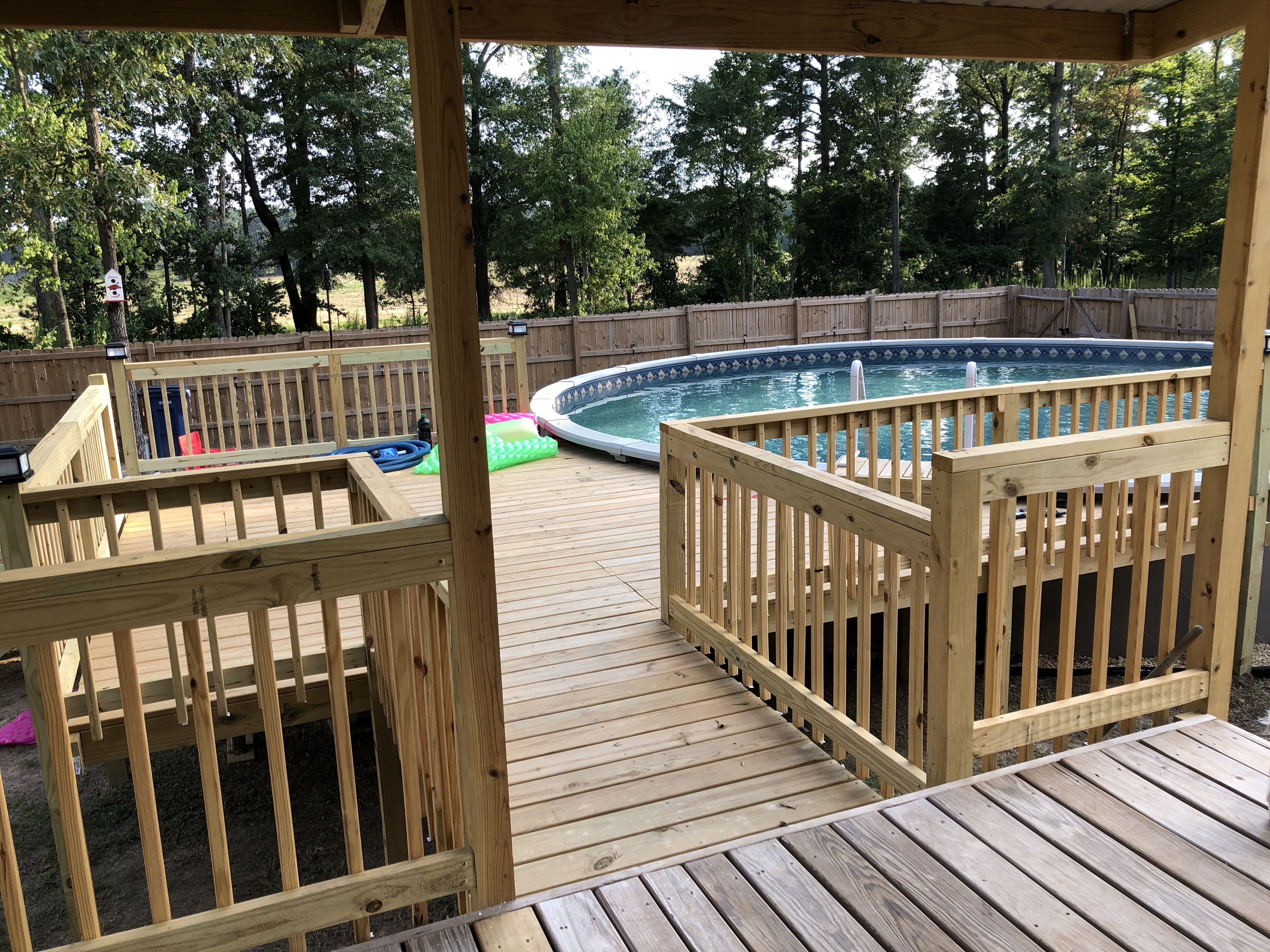 We Built This Deck Off The Existing Porch Pool By Azure Pools In Ruston Louisiana 30 Round Pool Pool Deck Plans Above Ground Pool Decks Pool Canopy