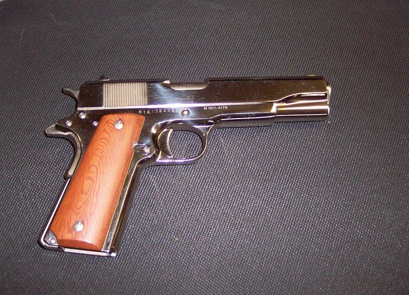 Standard chrome Rock Island Armory 1911 A1 with cheap wood grips