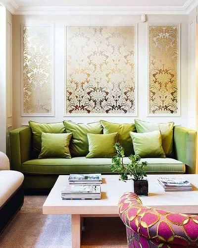 pink + green living room | blue kitchen cabinets, green sofa and