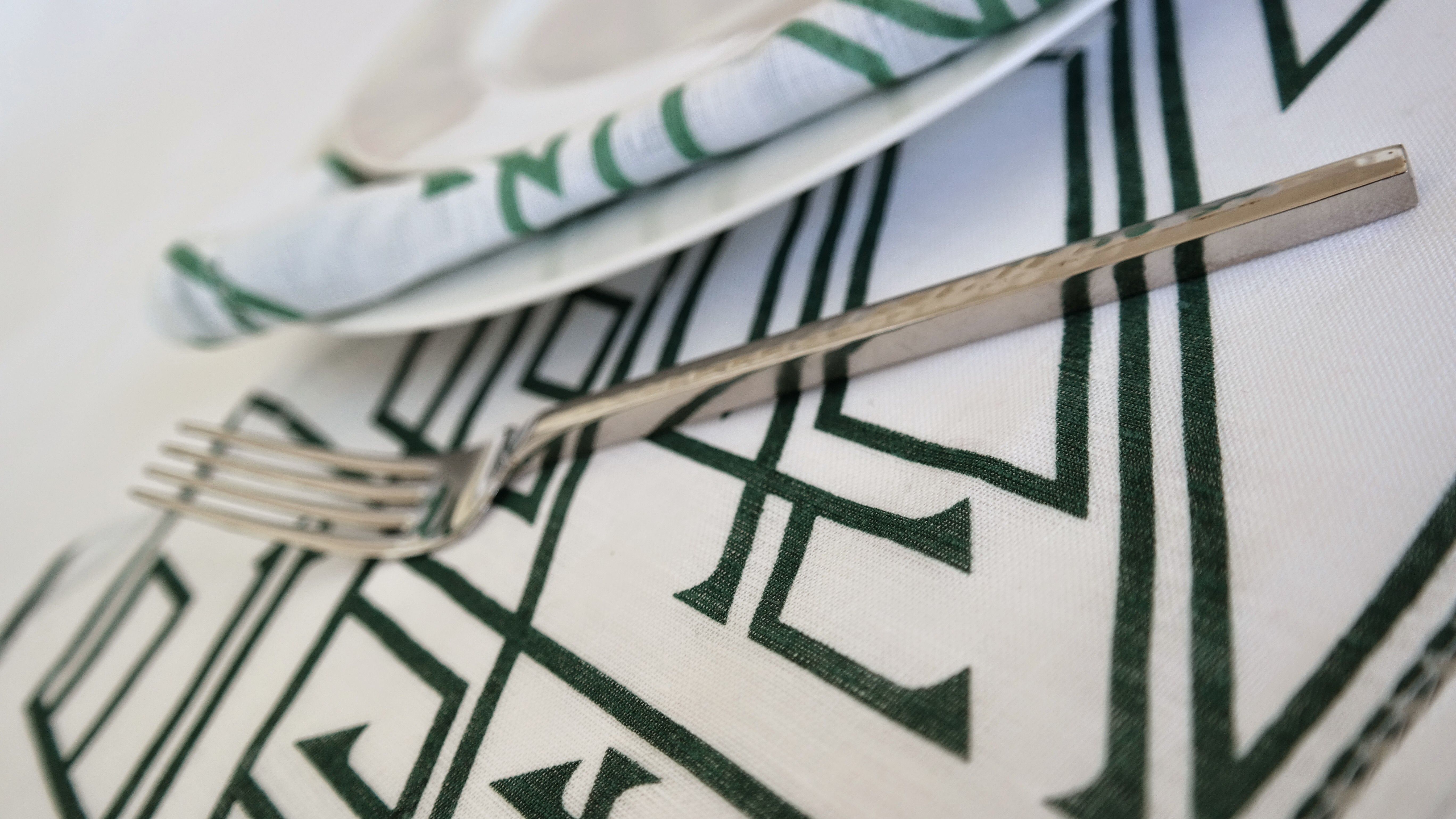 Tabletop with a modern kufic script shop our placemats and