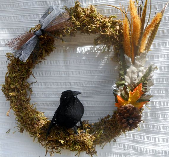 This has been sold but I could make another just like it.  I've covered this 12 x 12 Grapevine Wreath in moss with hotglue. It has a loop made of twine for hanging, which could be removed if desired by
