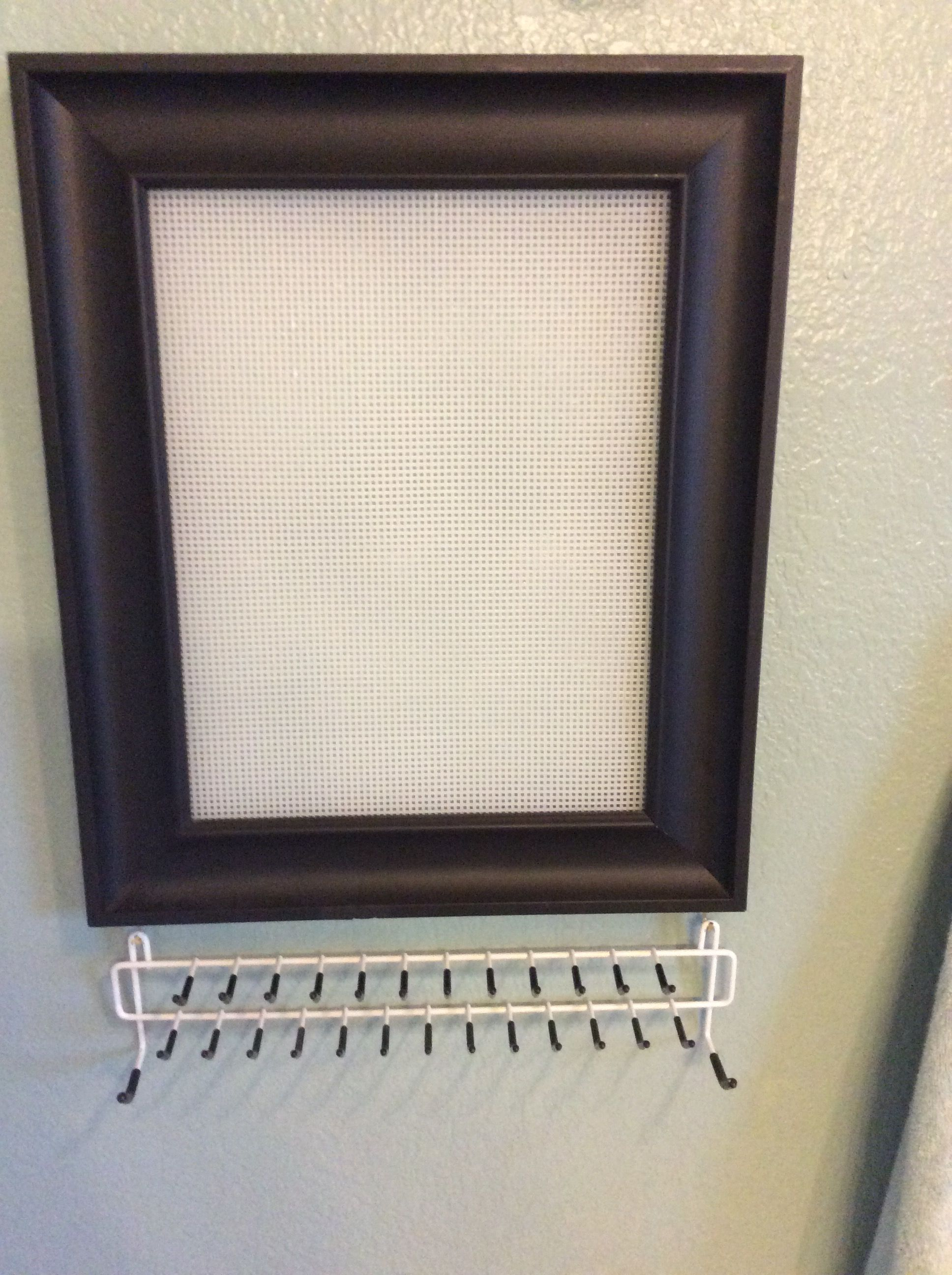 Jewelry organizer made using a plastic needlepoint canvas you can