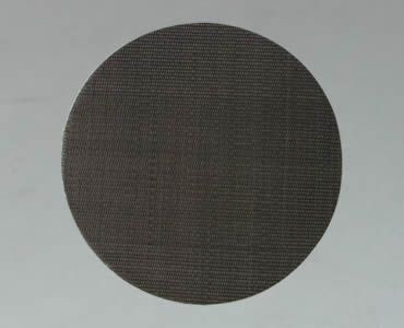 A piece of round filter disc made of black wire cloth.