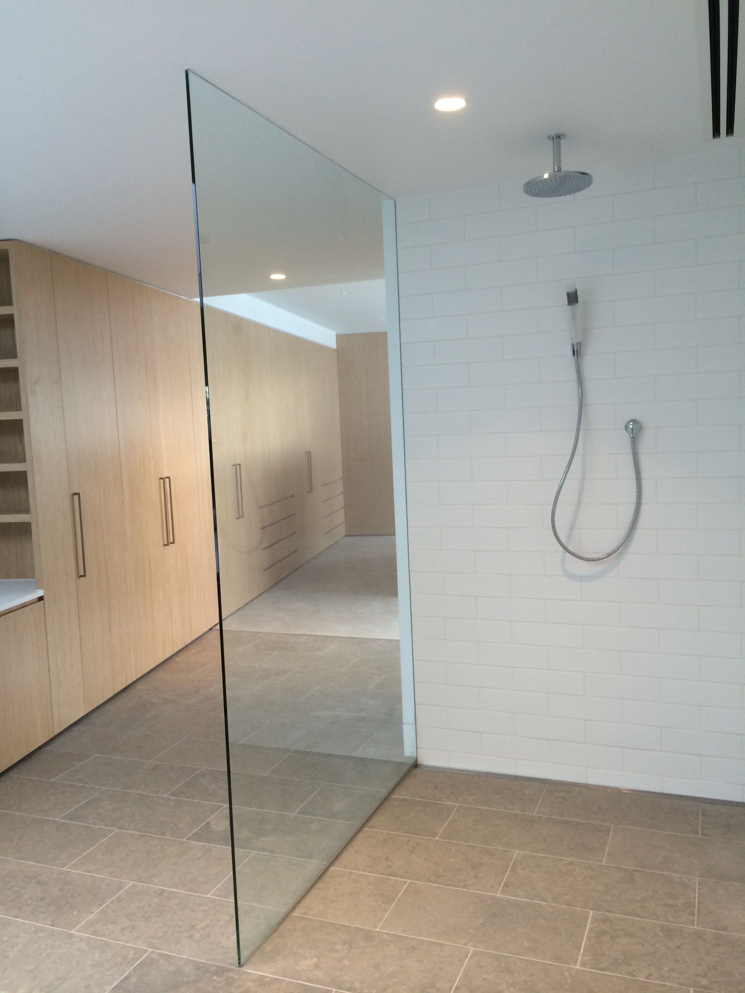 single panel floor to ceiling frameless shower screen