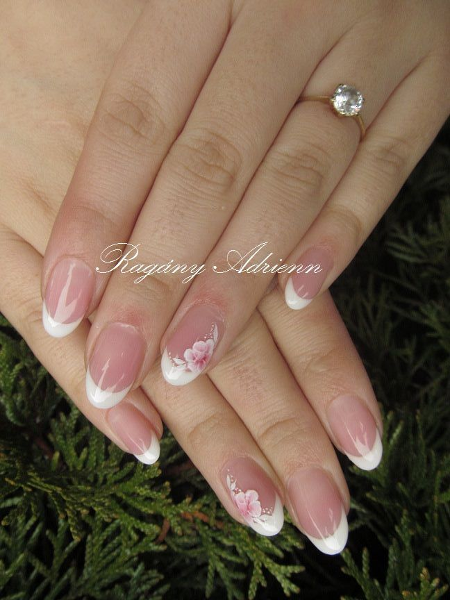 Photo of French nails with painted flowers