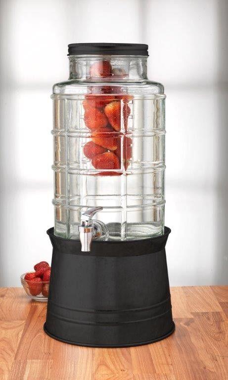 A Gl Beverage Dispenser With Metal Spigot