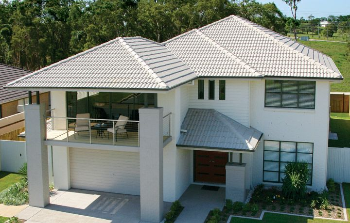 hip roof design with concrete roof tiles