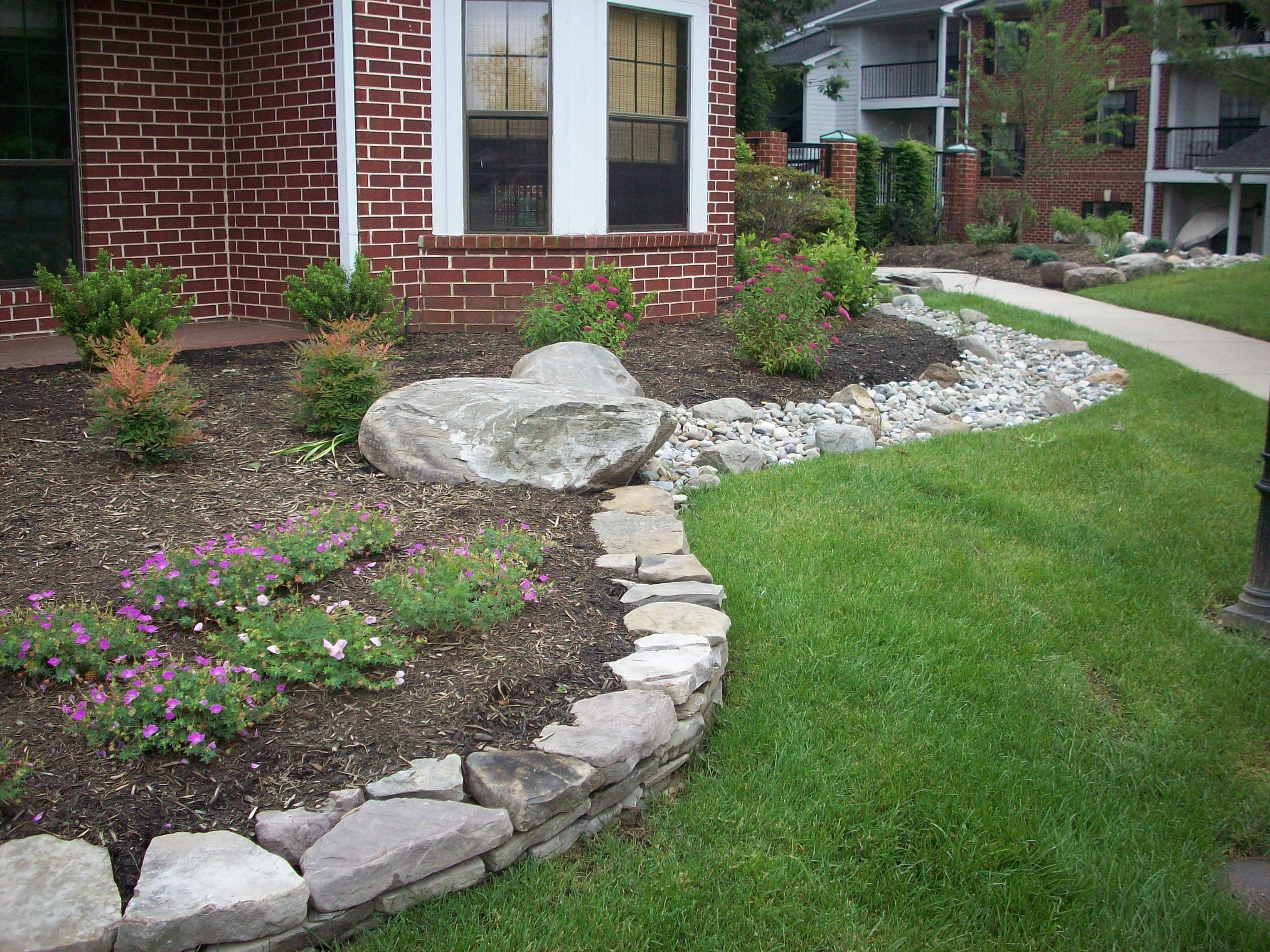 via Mainstreet Landscape. Stone raised bed, connected with