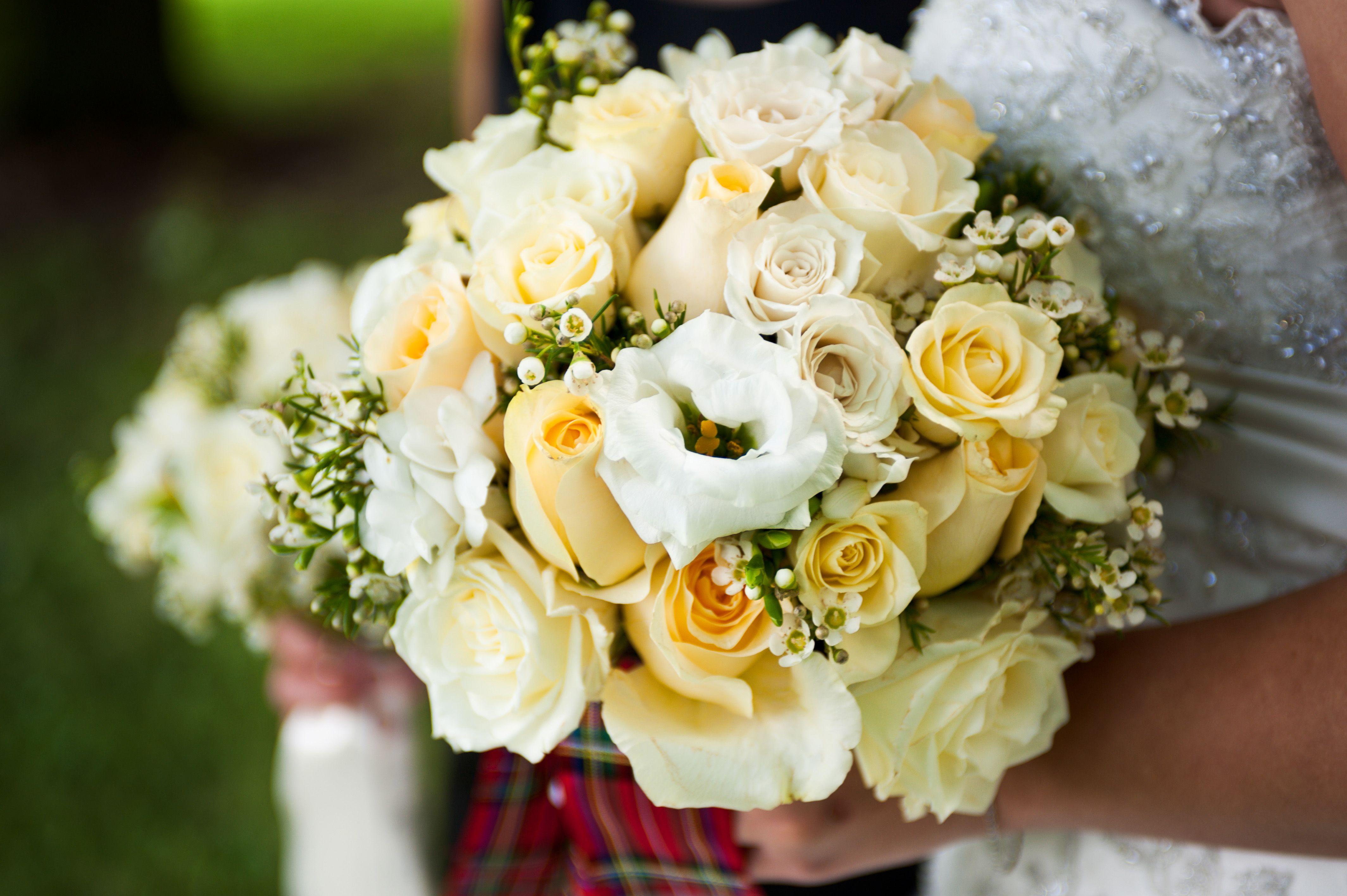 Gorgeous wedding bouquet showcasing white lisianthus ivory roses gorgeous wedding bouquet showcasing white lisianthus ivory roses cream roses pastel yellow izmirmasajfo Choice Image
