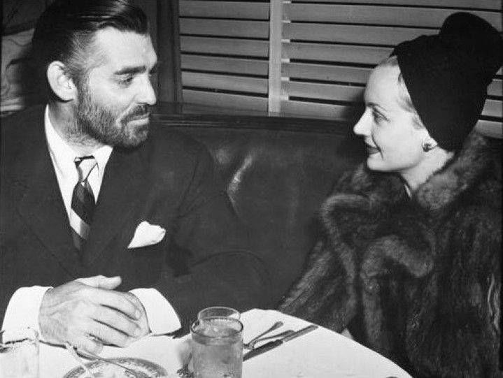 Carole Lombard with a rarely bearded Clark Gable.